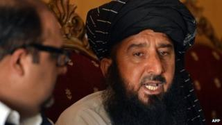 In this photograph taken on June 6, 2013, Pakistani tribesman Kareem Khan (R), speaks to media during a press conference in Islamabad.