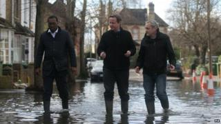 David Cameron inspecting floods