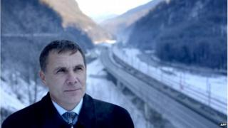 Environmental Watch ecology group activist Yevgeny Vitishko, standing in front of the new road between Adler and Krasnaya Polyana in the Black Sea resort of Sochi, in December 2013.