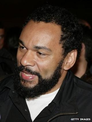 Controversial humorist Dieudonne M'Bala arrives to support the Front National's (FN) presidential candidate Jean-Marie Le Pen at the party election site following the first round of the French Presidential election on on 22 April 2007 in Paris, France.