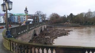 Flood debris trapped under the bridge