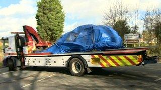 A vehicle being taken away by a recovery truck following a collision in Macclesfield, Cheshire