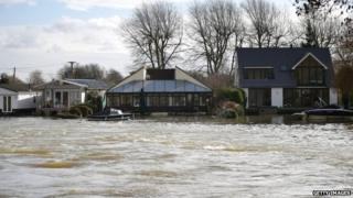 High water levels in the river Thames threaten housing near Penton Hook Weir