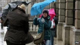 Pedestrians in Dublin's city centre struggled with their umbrellas as storms sweep across the country on Wednesday