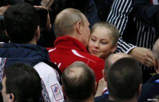 Russian President Vladimir Putin congratulates Yulia Lipnitskaya of Russia after the Team Figure Skating event