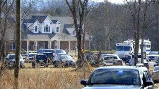 Police cars fill the front rural home in Lebanon, Tennessee where a package exploded 11 February 2014