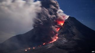 Sinabung volcano spews hot ash and lava in Karo, Indonesia on 14 January 2014