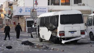 A damaged Bahrain police bus