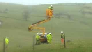 Engineers from ScottishPower working on lines in north Wales