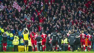 Aberdeen fans celebrate their Scottish Cup semi-final win at Celtic Park