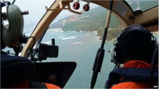 An Indonesian rescue team search for seven missing Japanese tourists
