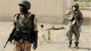 Nigerian soldiers patrol in the north of Borno state close to a Islamist extremist group Boko Haram former camp, file image from 2013