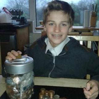 Boy with collection of pennies