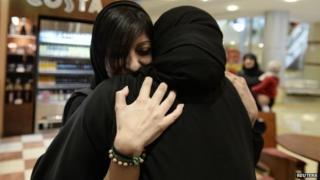 Zainab al-Khawaja hugs Sumaiya Rajab, the wife of jailed activist Nabeel Rajab, following her release (17 February 2014)