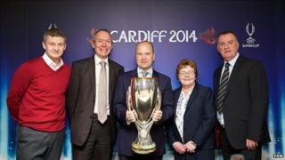 Former European club competition winners Ole Gunnar Solskjaer (left) and Kevin Ratcliffe (right) are either side of Welsh government Sports Minister John Griffiths, Jonathan Ford, chief executive of the Football Association of Wales, and Councillor Heather Joyce, leader of Cardiff council