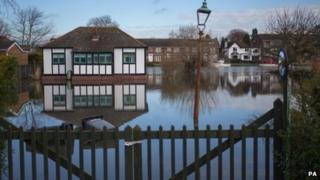A flooded home in Laleham Reach, Surrey
