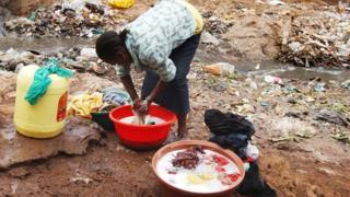Washing in a slum