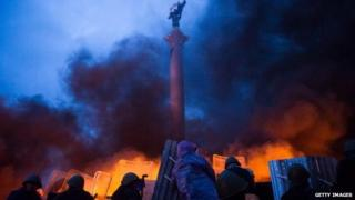 Flames light up Independence Square in Kiev during protests on 20 February , 2014.