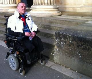 Clive Dainty in wheelchair