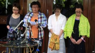 Japanese divers, from right: Nahomi Tomita, Atsumi Yoshidome, Emi Yamamoto, and Aya Morizono talk to journalists at a hospital in Bali, Indonesia, 20 February 2014
