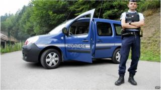 A French gendarme blocks a road leading to the scene of the shootings in 2012