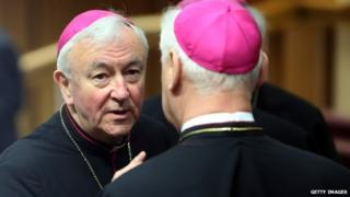 Vincent Nichols chats with German archbishop Gerhard Ludwig Muller