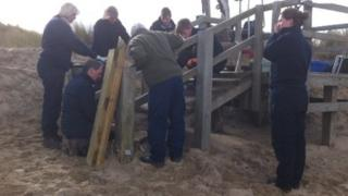 Rangers and volunteers carry out repairs