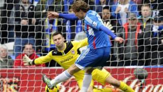 Hull's Nikica Jelavic scores past Cardiff goalkeeper David Marshall