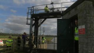 Workers raising the Monksleaze sluice gate near Langport