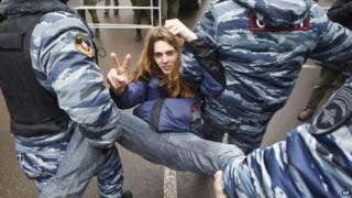 Russian police officers detain an opposition activist outside a court room in Moscow, Russia, on Monday, where hearings opposition activists detained in a May 2012 rally at Bolotnaya Square in Moscow were sentenced