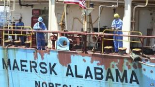 Crew members work aboard the US flagged Maersk Alabama after the ship docked in the harbour of Mombasa, in Kenya 22 Novembers 2009