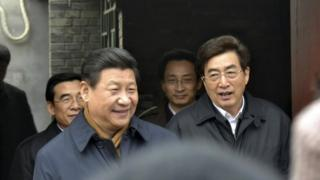 People in a Beijing neighbourhood greeted Xi Jinping (left) on Tuesday