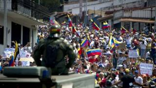 People attend a march during a protest against the government of President Nicolas Maduro in San Cristobal, capital of the western border state of Tachira, on 22 February, 2014