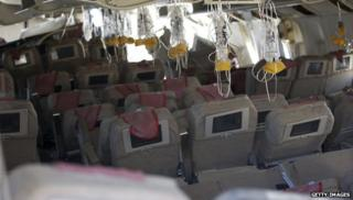 Oxygen masks hanging from ceiling of ruined Asiana plane