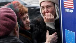 Ukrainian women worry about their savings