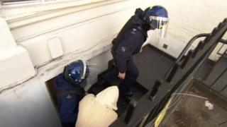 A man is led from a property in Highgate