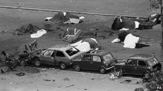 The bodies of horses under blankets after the Hyde Park bombing