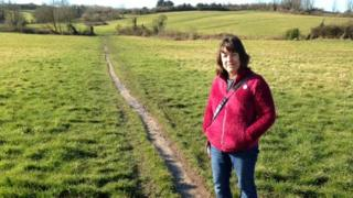 Gill Taylor standing in a field