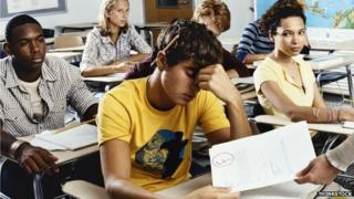 A man is handed an exam paper he has failed
