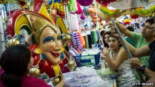 Brazilian consumers looking top spend at a carnival stall