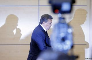 Ukrainian President Viktor Yanukovych leaves after his news conference in Rostov-on-Don, Russia, 28 February
