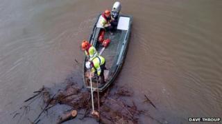 Clearing debris from Worcester bridge