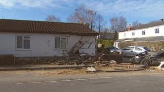 Damaged car and property