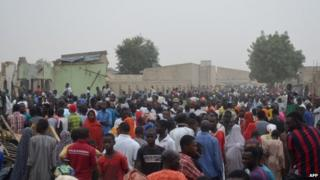 People gathered on the spot after two explosions rocked in Maiduguri, north-eastern Nigeria, a region plagued by Islamist insurgency of Boko Haram.