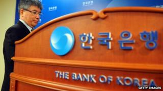 Kim Choong-soo in front of bank of korea sign