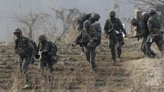 Army soldiers move during a military exercise in Paju near the border with North Korea, South Korea 28 February 2014