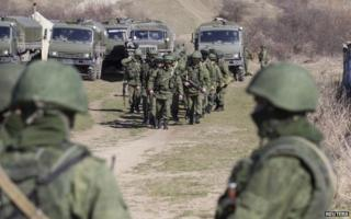 Soldiers believed to be Russians outside the territory of a Ukrainian military unit in Crimean village of Perevalnoye