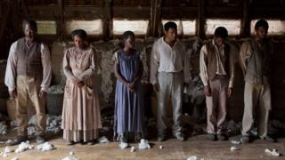 Lupita Nyong'o and Chiwetel Ejiofor (centre) in 12 Years a Slave