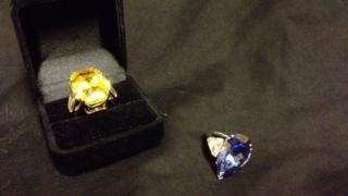 Fake yellow diamond ring and fake pear-shaped blue diamond