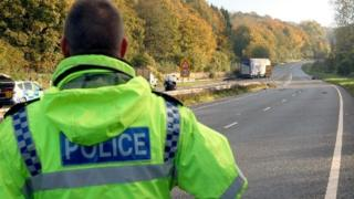 Police officer on the A417 following a fatal crash
